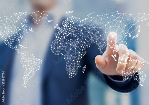 Fotografía Global business and finance concept with businessman touching world map with con