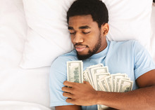 Man Sleeping With Lots Of Currency Notes