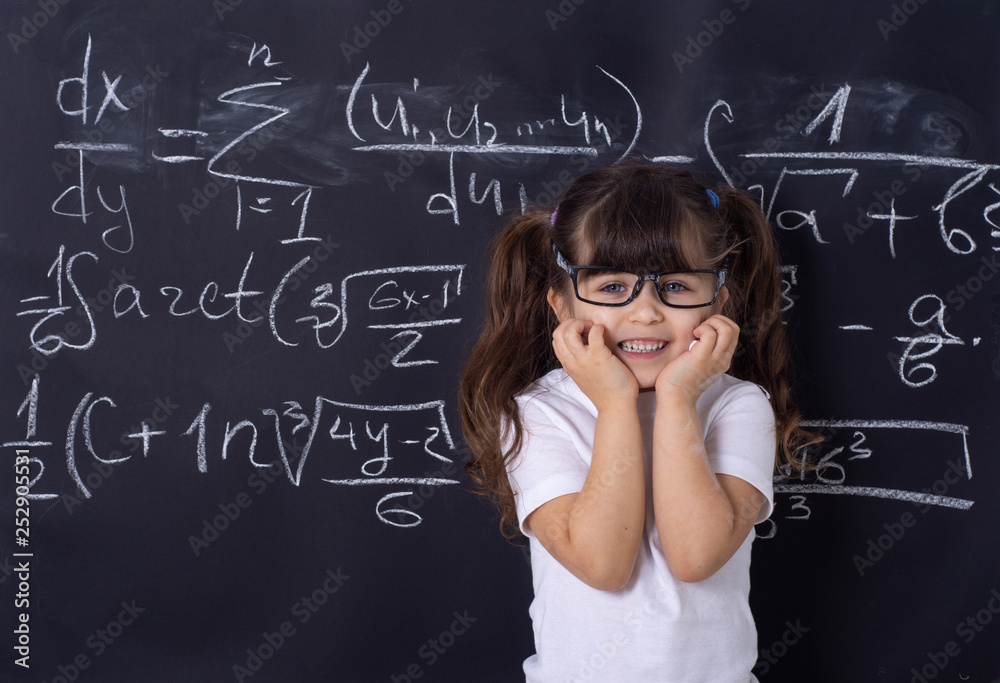 Fototapety, obrazy: Cheerful smiling child at the blackboard. School concept