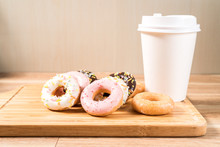 Donuts And Coffee On Wooden Ta...