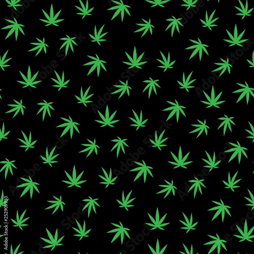 Photo  A lot of cannabis leaves. Green leaves on a black background