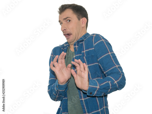 Fotografía  Photo of young man, afraid and terrified with fear expression stop gesture with hands