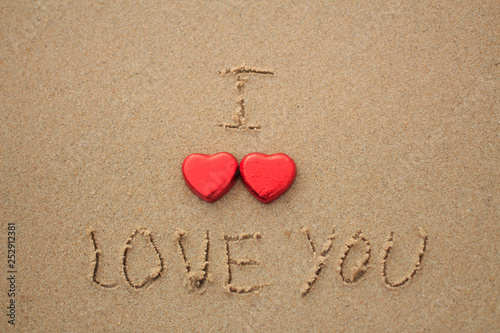 Fotografie, Obraz  Chocolate color Lovely red heart on the beach