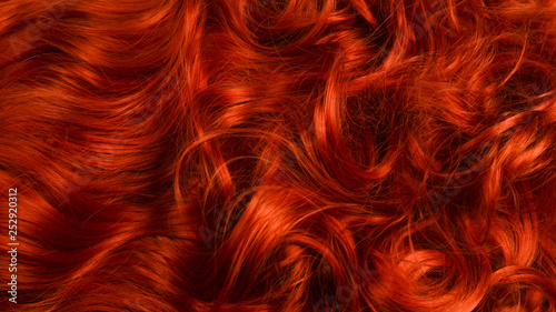 Fotografia Red hair background. Curly red hair.