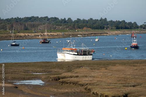 Fototapeta Twin hulled shellfish boat returning with catch obraz na płótnie