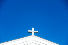Close Up View Of Christianity Cross Of Jesus Christ On Top Of A Church