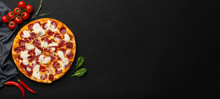 Pepperoni Pizza On Black Background, Top View