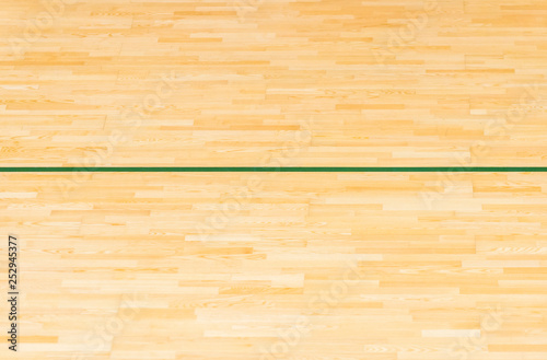 Photo Green line on the gymnasium floor for assign sports court