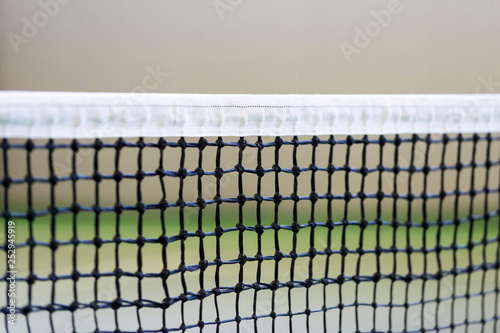 Photo  Net of tennis court on gray wall background