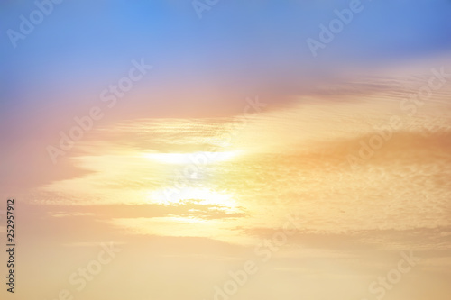 Fotobehang Zandwoestijn Colorful vibrant dramatic sky with sunset sun covered with clouds. Sunset time. Beautiful nature background