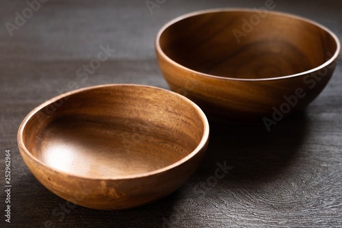 acacia bowl on black table