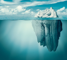 Iceberg In Ocean Or Sea. Hidde...