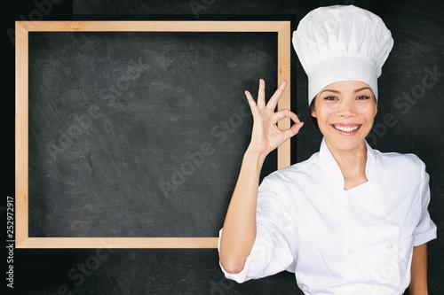 Obraz na płótnie Happy chef doing perfect okay hand sign at empty menu black board background