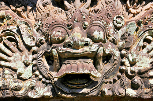 Fotomural Carvings depicting demons, gods and Balinese mythological deities can be found throughout the Pura Dalem Agung Padangtegal temple in the Monkey Forest Sanctuary in Ubud, Bali, Indonesia