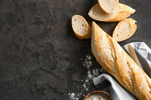 Cut French Bread With Flour On Grey Background