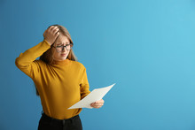 Displeased Girl With Results Of School Test On Color Background