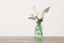 Eucalyptus Twigs And Roses  In  Glass Vase On White Background