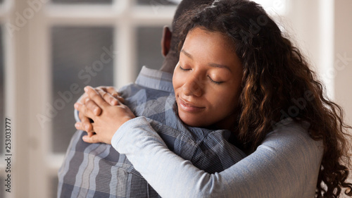 Photo Loving girlfriend hug boyfriend happy to reconcile after fight