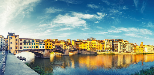 Scenic view on Ponte Vecchio in Florence, Italy, on a summer day. Colorful travel background. Panorama view.