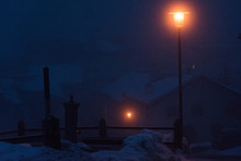 Snowy Night In A Village Up In The Alps