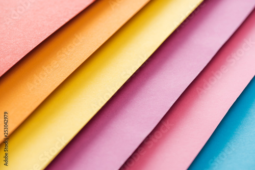 blue, orange, burgundy, yellow, and pink sheets of paper with copy space
