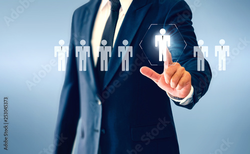 Cuadros en Lienzo Businessman touching person virtual button about the concept of recruiting person and Personal development