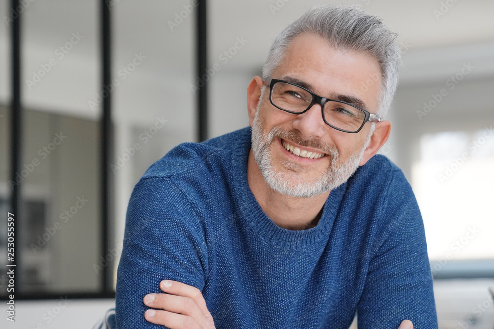 Fototapety, obrazy: Portrait of smiling man with grey hair and glasses