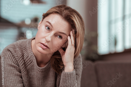 Fototapeta Wife having strong headache after big fight with husband obraz na płótnie