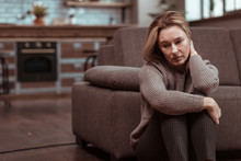 Woman Wearing Brown Squared Trousers Feeling Depressed