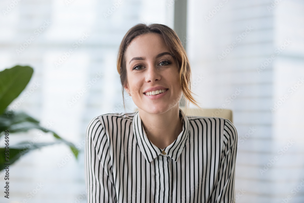 Fototapeta Smiling businesswoman looking at camera webcam make conference business call