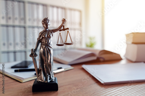 Lady Justice statue in law firm office Фотошпалери