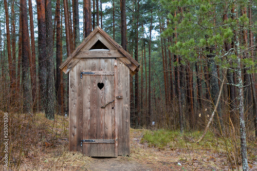 Leinwand Poster wooden outhouse
