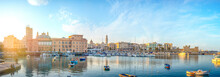Bari, Puglia, Italy - Panoramic View Of Waterfront And Harbor With Boats - Margherita Theater, Cathedral And Fort Of Sant'Antonio. Panorama At Sunset