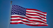 USA Flag In The Wind Against Clear Blue Sky, 3d Illustration
