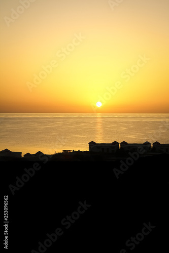 Beautiful early sunset on the sea background #253096562