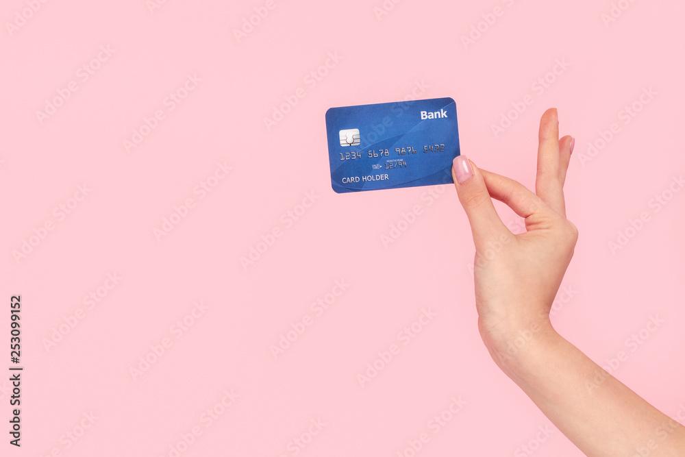Fototapeta Coquette girl holding bank card