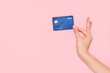 canvas print picture - Coquette girl holding bank card