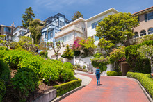 Young Woman Wearing Backpack Is Walking On The Lombard Street In San Francisco, USA. Travel And Adventure Concept.