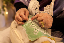 Elderly While Embroidering A Lace In Burano Island Near Venice In Italy