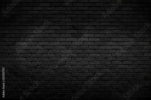 Foto op Plexiglas Historisch geb. The old vintage black bricks wall with lighting decoration in dark tone style on architecture and background design concept