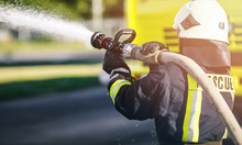 Firefighter In Uniform And Helmet . Rescue Man.