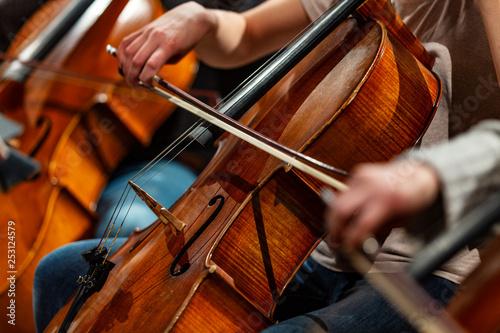 Photo sur Toile Amsterdam Orchestra Cello Players Background