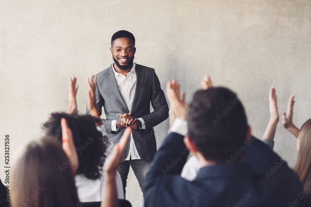 Fototapeta Audience clapping hands to speaker after business seminar