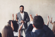 Audience Clapping Hands To Speaker After Business Seminar