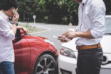 Two Drivers Man Arguing After A Car Traffic Accident Collision And Making Phone Call To Insurance Agent, Traffic Accident And Insurance Concept