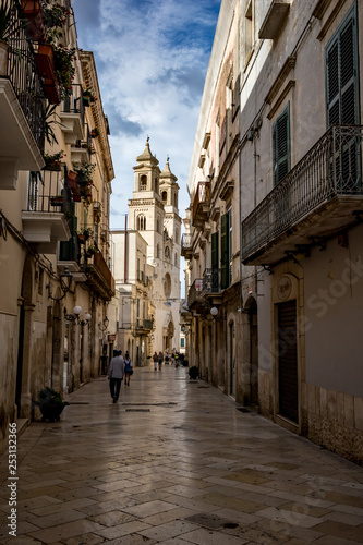 Fényképezés ALTAMURA, ITALY - AUGUST 26, 2018: People passing by Santa Maria Assunta Cathedral in the historical center of Altamura in Puglia region