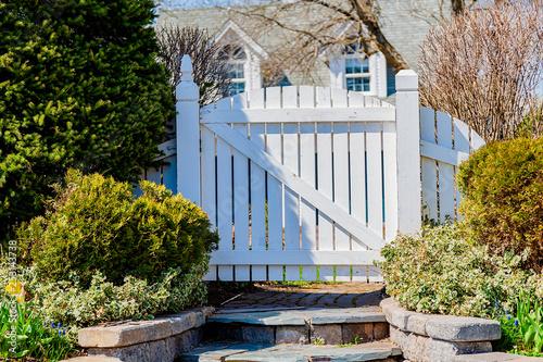 A wooden garden gate in a spring garden.