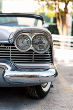 Front Side And Headlights View Of A 1957 Plymouth Vintage Car In Izmir Turkey.