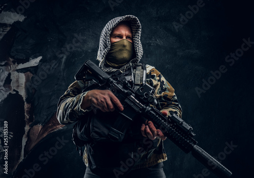 Close-up portrait of a Special forces soldier in military uniform wearing mask a Canvas Print