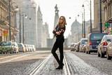 Fototapeta Miasto - Woman on the street of the city of Lodz.